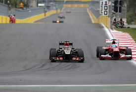 Kimi Raikkonen, Lotus, passes Fernando Alonso, Ferrari, Korean GP 2013
