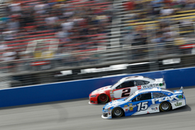Busch holds off Larson to clinch win