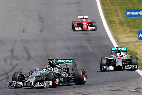 Rosberg holds off Hamilton for win