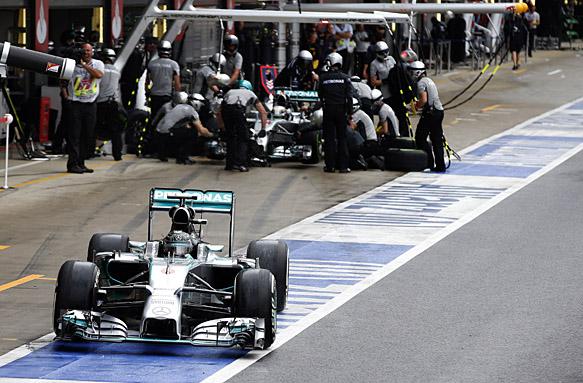 Nico Rosberg and Lewis Hamilton pit. British GP 2014