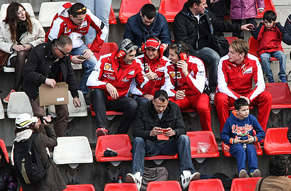 Ferrari team members in the Barcelona grandstand, F1 testing 2015