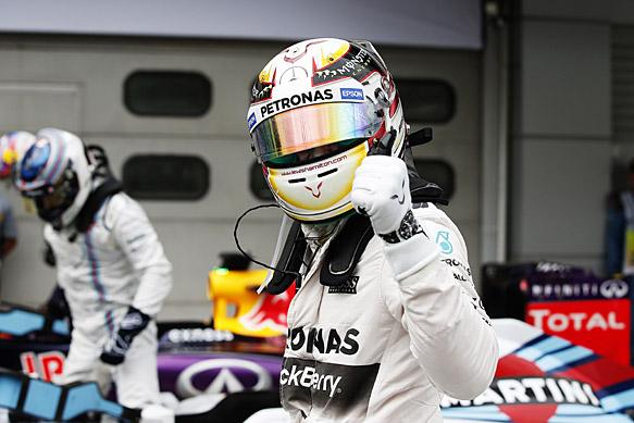 Hamilton resists Vettel for pole