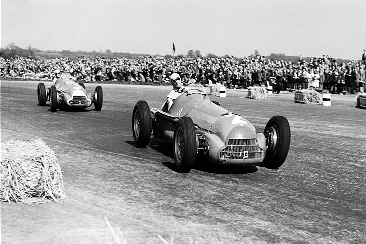 Giuseppe Farina leads Juan Manuel Fangio in the 1950 British GP