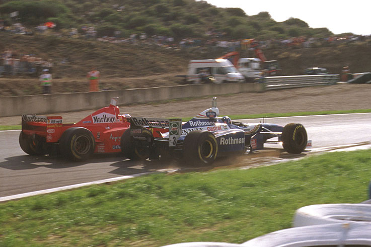 Jacques Villeneuve wins the F1 title after surviving an assault from Michael Schumacher at the finale