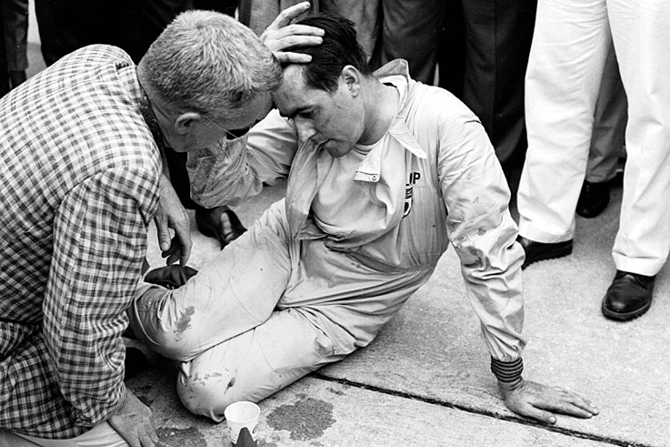 Jack Brabham collapses after pushing his car across the finish line at Sebring to claim his first title