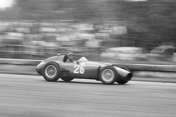 Juan Manuel Fangio wins his fourth title after taking over team-mate Peter Collins' Ferrari at Monza