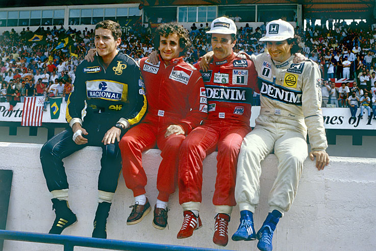 Four drivers go into the last two grands prix with a chance of the title, which Alain Prost wins