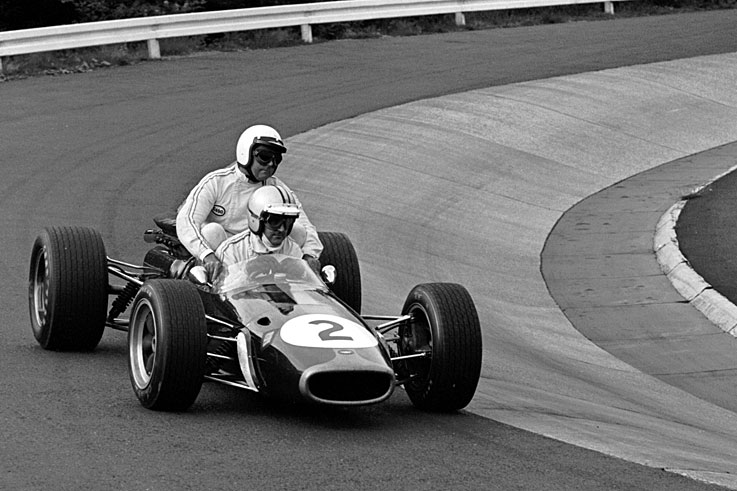 Denny Hulme (pictured giving team-mate Jack Brabham a lift) becomes New Zealand's only F1 world champion