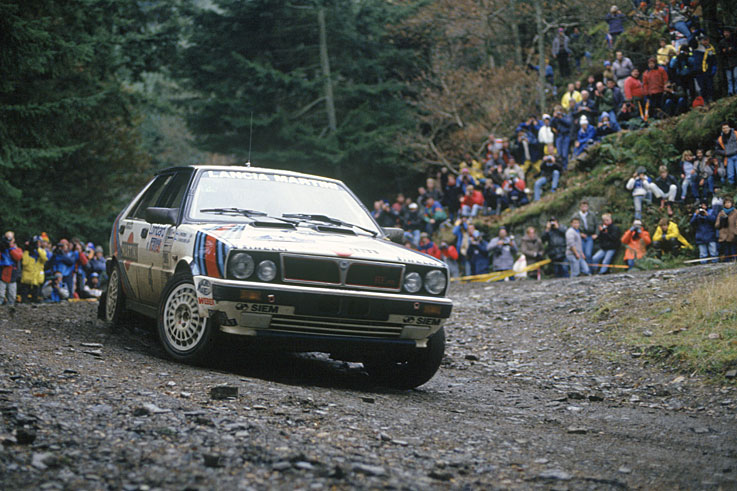 Juha Kankkunen switches from Peugeot to Lancia and becomes the first back-to-back World Rally champion