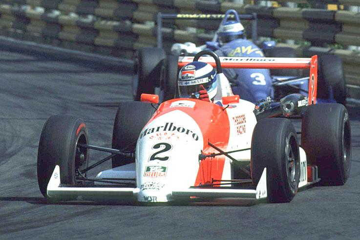 Michael Schumacher (#3) wins the Macau Grand Prix after colliding with Mika Hakkinen (#2)