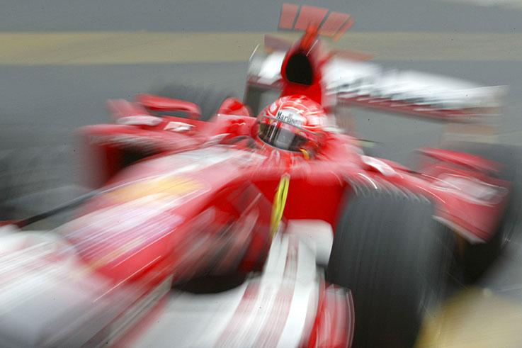 Michael Schumacher clinches a record seventh Formula 1 world championship