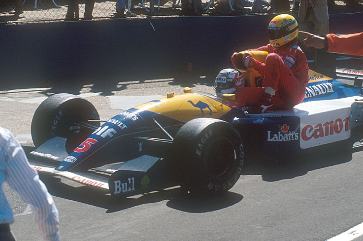 Nigel Mansell gives Ayrton Senna a ride back to the pits after winning the British Grand Prix