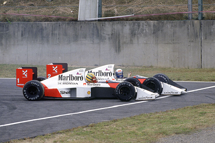 Alain Prost wins his third world championship after colliding with Ayrton Senna at Suzuka