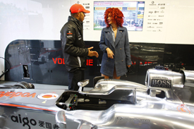 With time on his hands after retiring from the race, Lewis Hamilton shows Rihanna around the McLaren