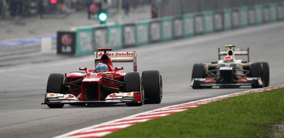 Fernando Alonso Sergio Perez Ferrari Sauber 2012 Malaysian Grand Prix