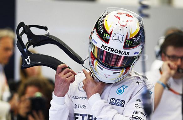 Lewis Hamilton with HANS device, F1 2015